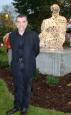 Jaume Plensa poses with his sculpture in Shorewood, WI.